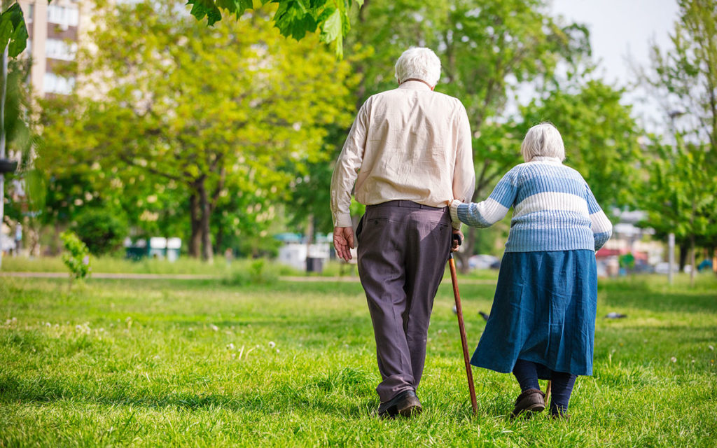 Senior couple walking outdoors in spring